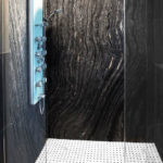 Ancient Woodgrain Bolder Panel installed in a shower
