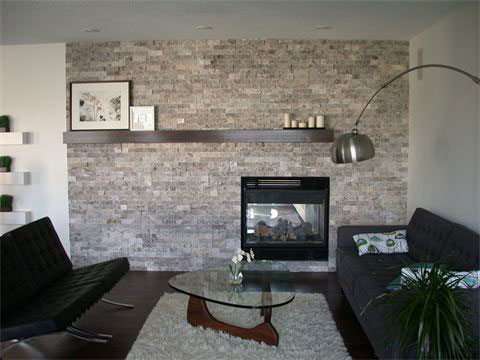 Silver Splitface Random Strip Ledgestone installed on a fireplace