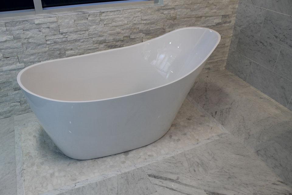 Freestanding Fleurco Tub with marble surround