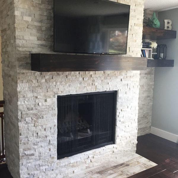 Muskoka Saddle Porcelain and Fantasia Slate Splitface installed on a fireplace