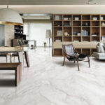 Snow Shadow Marble Imitation Porcelain Tile installed in an open concept dining and living room